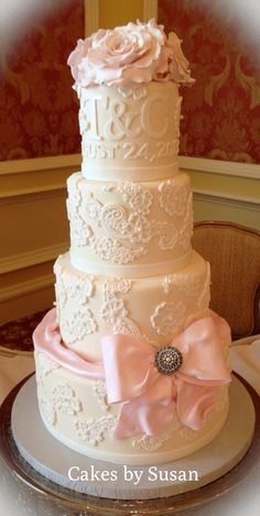 Lace wedding cake with sugar bow and roses