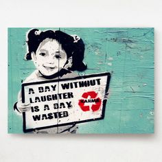 Charlie Chaplin Quote: A day without laughter is a day wasted, Karma Graffiti, Amsterdam.