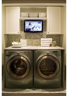 now THIS is how you do a laundry room! tabletop for folding, simple cabinets to hide stuff, and a tv for watching while folding! @ House Remodel Ideas - Fox Home Design Home, House Styles, House Design, Room Inspiration, Laundry Room, Home Remodeling, New Homes, Laundry In Bathroom, Home Projects