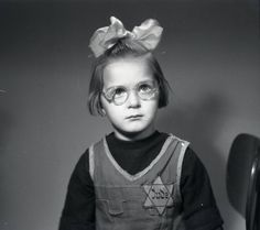 Žofie Adlerová, seen as a child during the Nazi occupation of Czechoslovakia (ca. 1943). She reportedly survived the war and emigrated to the United States. Via the Židovské Muzeum v Praze