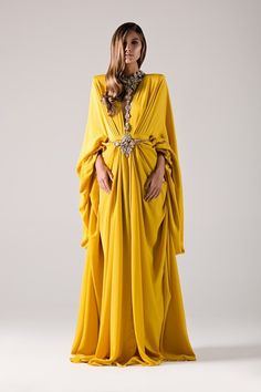 Golden yellow draped kaftan with strong shoulders.- Michael Costello US Size Chart- Made true to size- Include the inches of your heels to your height- Dry clean only- Jewelry not included Modest Fashion, Hijab Fashion, Girl Fashion, Mono Formal, Michael Costello, Mode Abaya, Africa Dress, Fantasy Gowns, Couture Dresses