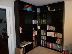 Materials: Billy Bookshelves, Benno DVD Tower  Description: Billy has corner bookshelves combo.