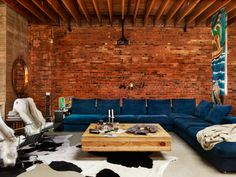 blue couch and brick