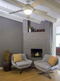 Team Jonathan opted for a pair of midcentury modern chairs as part of its living room makeover on HGTV's Brother vs. Brother. The low-slung seating brings a bit of retro flair to the sitting room with a painted brick fireplace.