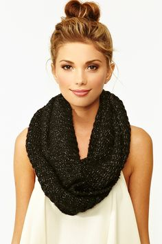 Totally essential black infinity scarf featuring metallic gold threading. Perfect paired with a chiffon blouse and skinnies!