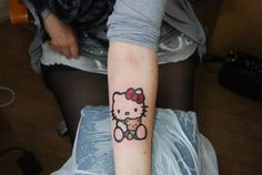 really well done ink. hello kitty tattoo arm