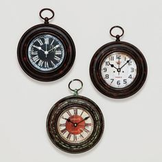 One of my favorite discoveries at WorldMarket.com: Magnetic Metal Clocks.  Love these.  Sold out, last I checked. :(  Jan 2014 - they're back!  I got the one with red.