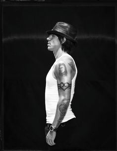 Anthony Kiedis.  I've always loved his tattoos. They're somewhat iconic to me, and this heart tattoo was an inspiration for my heart tatoo.