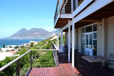 Moonglow Guest House is a 4 star guesthouse just outside Simon's Town. Nestled between pristine mountains and the waters of False Bay Cape Town South Africa Cape Town Accommodation, Cape Town South Africa, Mansions, House Styles, Places, Water, Outdoor Decor, Houses, Home Decor