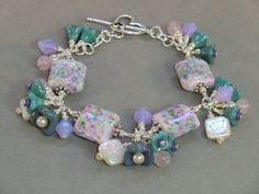Pink lavender and teal  lampwork beaded bracelet by wilywolverine, $42.95