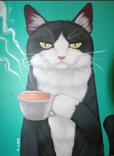 Tuxedo cat with mug of coffee