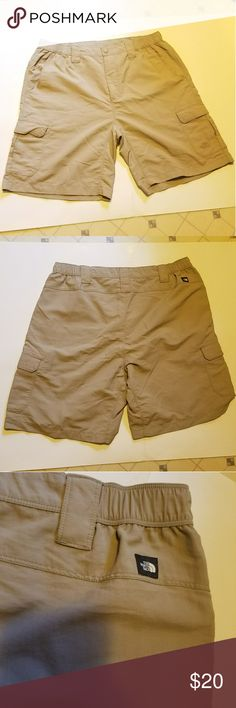 The North Face Shorts Men's Tan Shorts 100% Polyester Side pockets, belt loops, Velcro Cargo pockets XL Good condition never worn The North Face Shorts Cargo