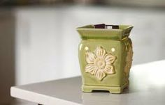 Daphne Mid-Size Scentsy Warmer by Authentic Scentsy. $35.00. Aquatic blossoms float among the lily pads, taking you outdoors to a tranquil country pond.. Aquatic blossoms float among the lily pads, taking you outdoors to a tranquil country pond.