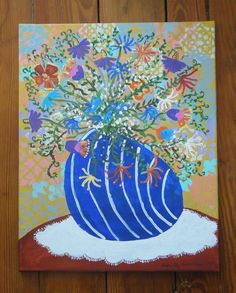 $89 This funky vase is modeled after one I gave my husband the first time we met. In the picture, it sits on a doily atop a table and is filled