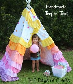 DIY handmade ruffled tent tutorial.  The rainbow tent can be used indoors and outdoors.  Easy to store when not in use.