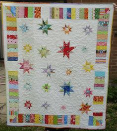 Wonky star quilt.  Love the variations in size (although tiny wonky stars are beautiful) and the border.