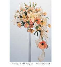 Soft orange Asiatic lilies and Gerbera daisies dominate the theme of this bouquet. Regular daisies, roses and miniature carnations finish it out. Cascading Wedding Bouquets, Bridal Flowers, Floral Bouquets, Wedding Reception Decorations, Wedding Ideas, Wedding Stuff, Dream Wedding, Peach Flowers, Gerbera Daisies