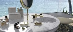 A luxury marble bathroom vanity which proposes a new way of envisioning the bathroom area.   An iconic design for furnishing luxury homes and boutique hotels of prestige and exclusivity. Our bathroom solutions celebrate craftsmanship, exquisite materials and fine detail. Built in table top mirror and washbasin for added functionality. #luxurybathroom
