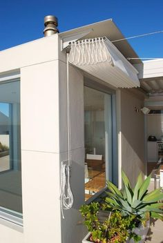 The concertina retracting awning folds away attractively under its own cover