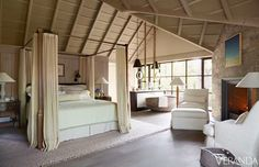 The canopy bed in this stunning room by John Saladino is the perfect thing for the space. The height of the bed draws the eye up to the beautiful, dramatic ceiling.   Image via Veranda