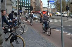 'Snorfiester'on cycle track, central Amsterdam, morning rush hour