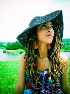 Like the hat, dreds and serene look on her face.