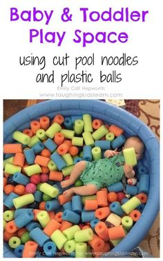 Baby and toddler play space using cut pool noodles and plastic balls