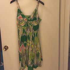 FumbLin 'foe Green Summer Dress This dress has a fun green, yellow, grey, white, and orange print go brighten up any day. The top has a cute lace detail at the v-neckline. Bring it home today! FumbLin 'foe Dresses Midi