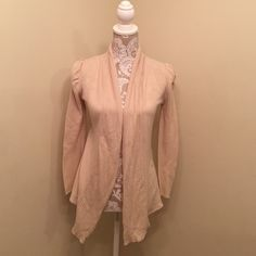 Tan cardigan In great condition. Sleeves are ruched and they give a nice classic look to dress up, or you can dress down with some jeans. There is a part on the neck that has become in threaded, but it does not affect the sweater whatsoever. Delias Sweaters Cardigans