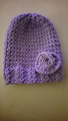One of the baby hats I've knitted for my shop. Baby booties hats knitting handmade etsy baby set winter flower https://www.etsy.com/shop/KnittingBabyBoutique