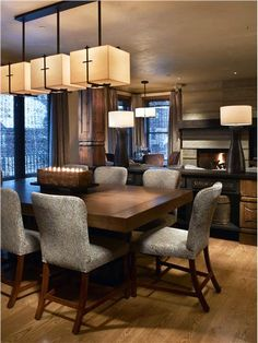 Transitional Dining Room Line the lighting and the chairs, soothing colors