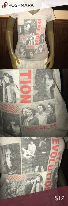 """Very Cool The Beatles Revolution Band V Neck Tee Very Cool The Beatles Revolution Band V Neck Tee - Awesome Pictures - Medium - 17"""" Pit to pit / 23"""" Top of the shoulder to the bottom of the shirt - One small pin hole near shoulder Tops Tees - Short Sleeve"""