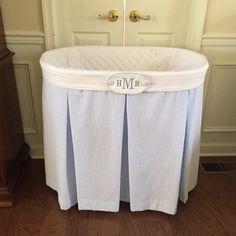 Monogrammed bassinet cover in seersucker