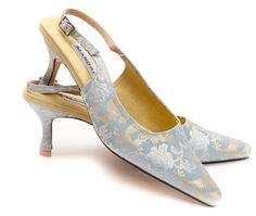 Now known as our Signature Shoe, this style featured on our very first mail shot and has been a long-standing Mandarina favourite ever since.  A great summer party shoe in the prettiest shade of silver-blue with a subtle dragon motif.  Elegant toe shape, 7cm heel, adjustable slingback.       If you have any queries regarding this style, or your size is out of stock, please contact us at  enquiries@mandarinashoes.com