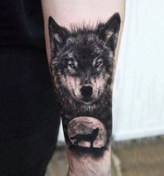 My first tattoo, realistic wolf and silhouette howling at the moon.: