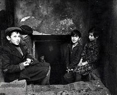 Roman Vishniac. Children seeking light and air outside their basement home, Krochmalna Street, Warsaw