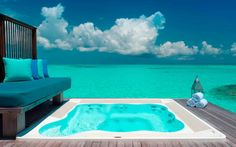 Conrad Maldives, Rangali Island, Maldives - Whether you opt for an overwater bungalow or beach villa, you can't go wrong with the Conrad Maldives's beautiful assortment of digs divided over two separate islands in the middle of the Indian Ocean. It doesn't matter anyway; either choice gets you a sprawling wooden sundeck and an infinity plunge pool the exact same shade of jade-blue as the glittering ocean beyond.