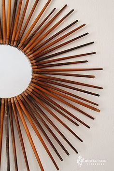DIY mirror with antique spindles.  Would be really cool with paintbrush handles!