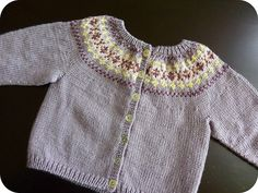 Ravelry: Beaded Fair Isle Cardigan pattern by Debbie Bliss Ravelry: Beaded Fair Isle Cardigan pattern by Debbie Bliss Baby Sweater Patterns, Baby Cardigan Knitting Pattern, Fair Isle Knitting Patterns, Knitted Baby Cardigan, Knit Baby Sweaters, Fair Isle Pattern, Knitting Designs, Sweaters For Women, Knitting For Kids