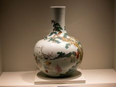 A porcelain Qing dynasty vase, decorated with a scene that indicated blessings for good fortune.