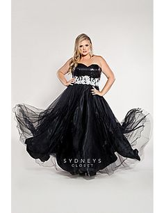 Make a dramatic entrance at any formal occasion wearing this updated black and white ball gown featuring an overall sequin bodice and strapless sweetheart neckline.  The elegantly beaded lace waistband gives way to a flowing full tulle skirt with pretty scalloped hem.  Optional straps and matching tulle shawl included. Perfect choice for a 2013 Prom Princess! Sydney's Closet Style SC6003 available in plus sizes 14 to 36. FINAL SALE! sonsi.com