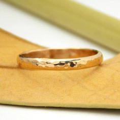 This Hammered Domed Band has been formed and textured by hand from half round wire. Polished to a high shine, this makes for a nice, simple ring for everyday wear. - Band measures approximately 2.5 mm