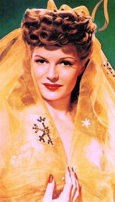 """RITA HAYWORTH mock """"Vanity"""" mag cover from Cover Girl (1944) Hand-colored dye transfer photograph (detail) by Robert Coburn. From 1940 he was Columbia's head of stills & chief portrait photographer for 20 years. With this film he became the first still photographer to be credited on screen.  From Masters of Starlight by David Fahey & Linda Rich. 1988. (please follow minkshmink on pinterest) #ritahayworth #robertcoburn #covergirl #columbia #colourportrait  #lovegoddess #glamourgirl #forties"""