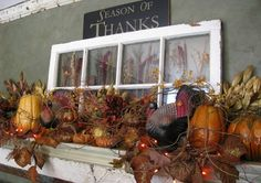 I like the sign and the glass over the fireplace mantle.  I would put different vibrant pumpkins, squashes, leaves for more color