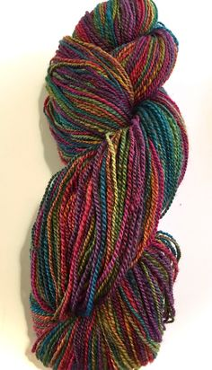 Handspun BFL Art yarn fingering wt. 350 yds. 2 ply. 4oz 114 grams. A beautiful rainbow of jewel tone colors. Ready to knit or crochet. by Bags4Ewe on Etsy