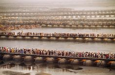 Crowds at the Kumbh Mela await their turn to bathe in the Ganges.  Allahabad, India