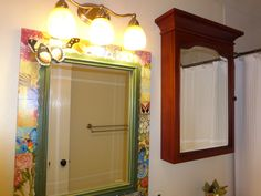 58. Hall bath mirror bought in Pier1, light fixture from Lowe's. Cabinet outlet store in Austin.