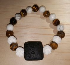 TIGERS EYE gemstone AROMATHERAPY bracelet / by GloriaEssentials - $19.99 Just add a drop of your favorite essential oil on the LAVA ROCK and enjoy the aromatic benefits!