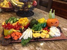 Halloween and Harvest Parties can be healthy! What an awesome display of raw veggies and dip for your guests.
