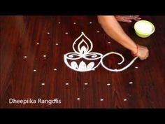 Simple Diya shanku Kolams with 7 dots Small Rangoli Design, Rangoli Designs Diwali, Rangoli Designs With Dots, Rangoli With Dots, Beautiful Rangoli Designs, Rangoli Borders, Rangoli Patterns, Rangoli Border Designs, Lotus Rangoli
